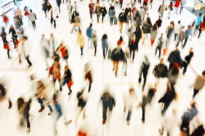 blurred scene of people walking