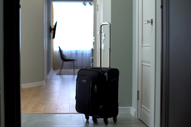 suitcase standing in an empty hallway