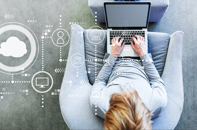 Aerial view of man sitting on a sofa working on a laptop